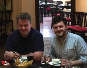 Photo of collaborators Martin Fenner and Joe Wass enjoying a meal together.